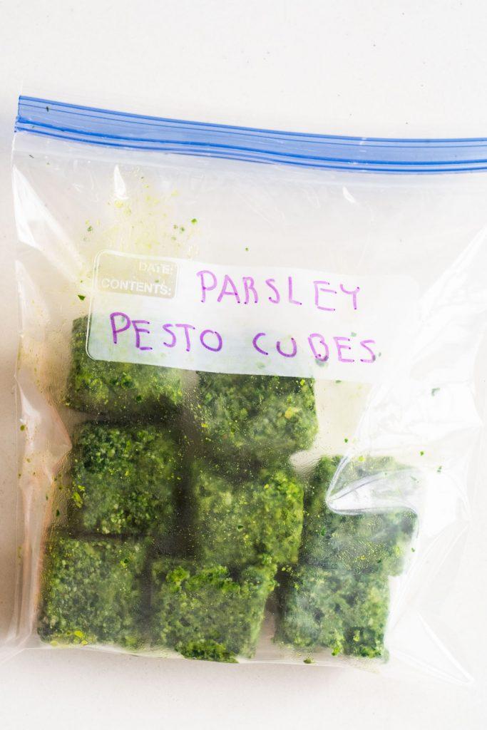 pesto cubes in freezer bag.