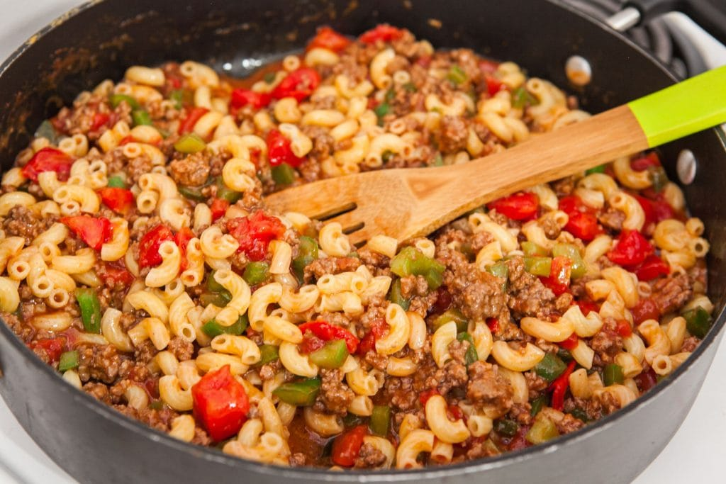 elbow noodles, ground beef, green pepper, diced tomatoes, tomato soup all mixed up in pan