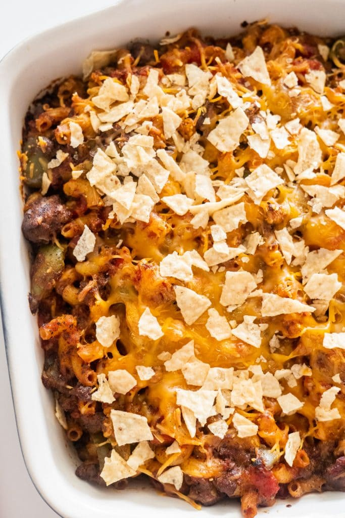 taco casserole baked in casserole dish with tortilla chips on top