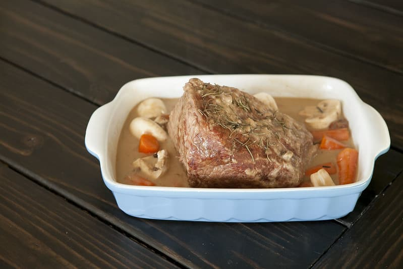 A melt in your mouth Slow Cooker Pot Roast recipe. Throw vegetables in at the end and you have a complete meal. This is perfect for Sunday dinner or holidays!