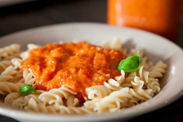 ROASTED Cherry Tomato Sauce is sweet, creamy and SO EASY to make! This is the best recipe for growing garden tomatoes! You can serve immediately on pasta, can it or freeze it! Find out why thousands of people love this sauce!