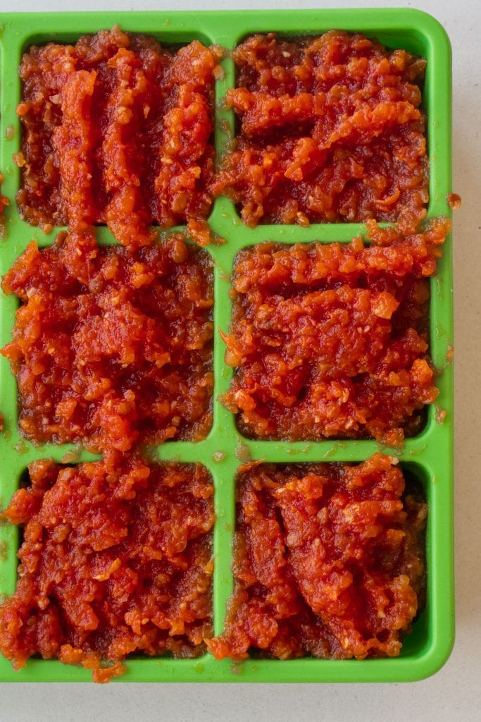 tomato paste in freen ice cube trays.