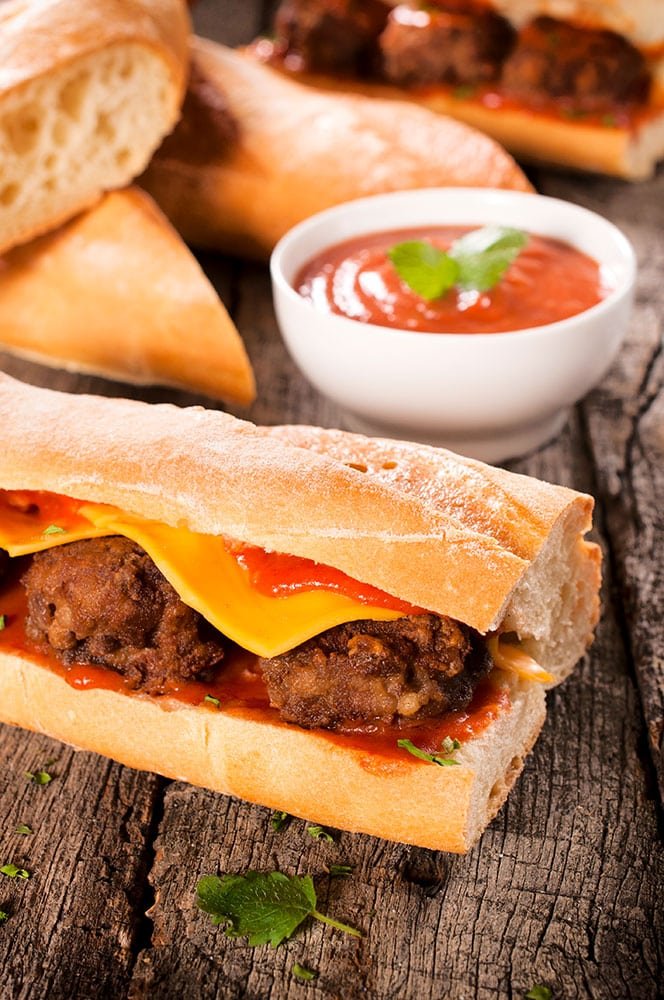HEALTHY Ground Turkey and Kale Meatball Sub! These meatballs are fried on the stove and then covered with tomato sauce and American cheese on asub roll! This homemade recipe is easy, healthy and your family will love it! Even my Midwest husband thinks this is the BEST meatball sandwich!
