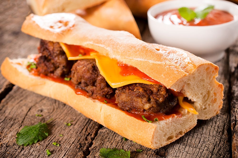 HEALTHY Ground Turkey Kale Meatball Sub!  These meatballs are fried on the stove and then covered with tomato sauce and American cheese on  a sub roll! This homemade recipe is easy, healthy and your family will love it!  Even my Midwest husband thinks this is the BEST meatball sandwich!