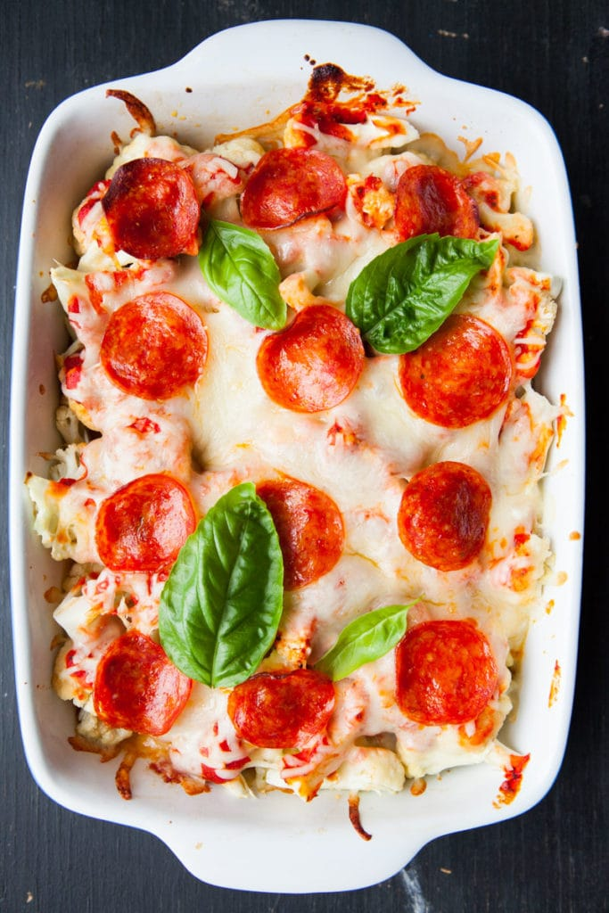 This pizza casserole with cauliflower is a one dish meal made with pepperoni, cauliflower and plenty of cheese, all mixed with pizza sauce. An easy dinner that's family friendly and quick to make!