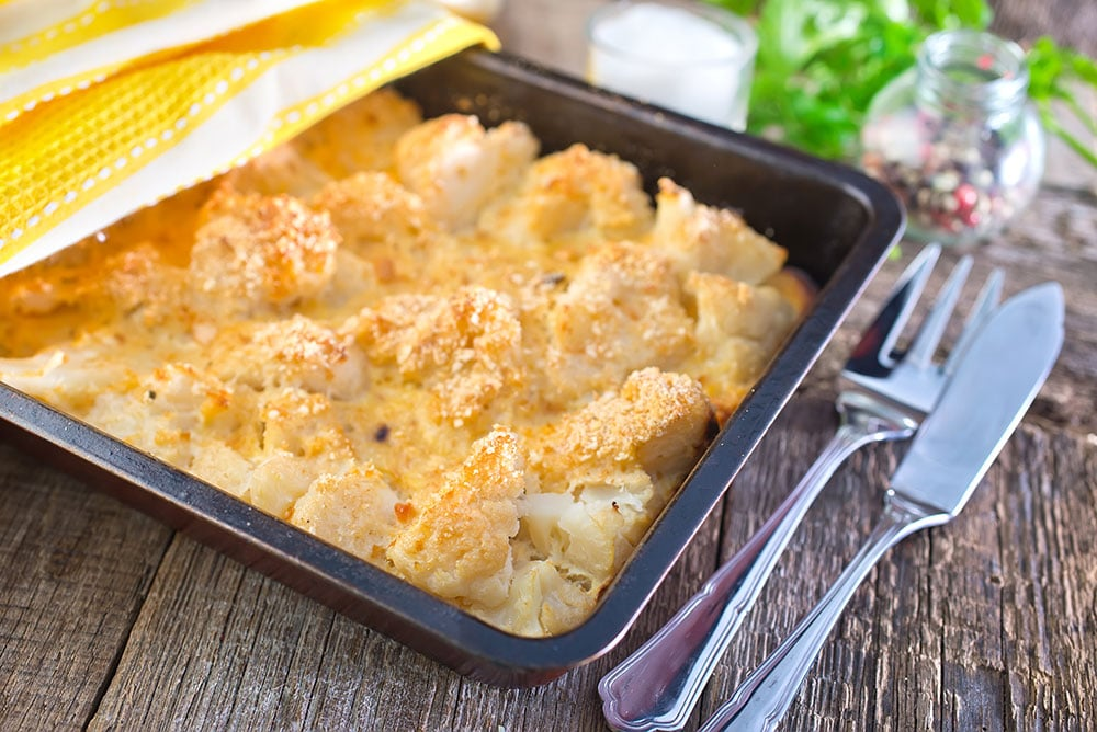 DOUBLE CHEESE Cauliflower Casserole is delicious comfort food! This easy to make loaded casserole recipe is made with both cheddar and Parmesan cheese to make it extra cheesy! It makes a great vegetarian main dish or holiday side dish.