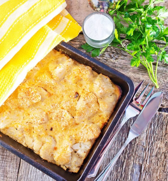 Easy Cheesy Cauliflower Casserole is delicious and only takes 10 minutes to prepare! This loaded casserole recipe is made with Cheddar and Parmesan to make it extra cheesy!  My family declares it one of their favorite side dishes on the holiday table! Low carb friendly.