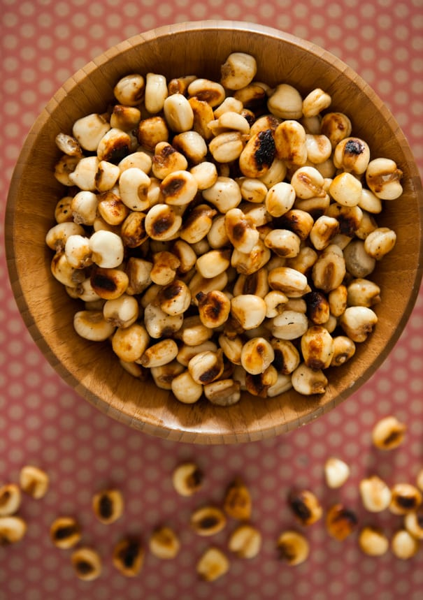 Homemade HEALTHY Roasted Corn Kernel Nuts that taste just like Corn Nuts you buy in the store! This DIY how to make corn nuts recipe is easy to make and only uses 4 ingredients! Bake them in the oven for 30 minutes for a healthy, perfect snack!