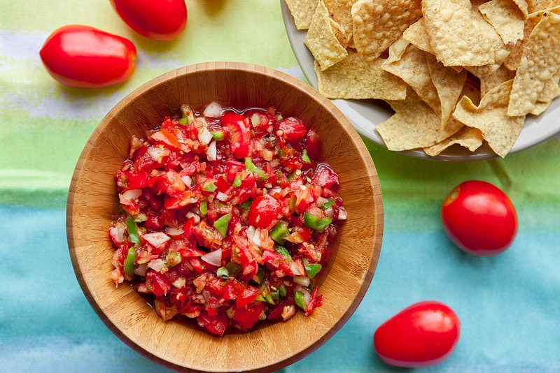 FRESH Tomato Salsa made with roma tomatoes straight from our garden!  This easy HOMEMADE recipe is made in minutes  with tomatoes, onion, peppers, cilantro, and red pepper flakes!  Friends BEG for me to make this salsa because it's everyone's favorite! Serve with Chips or with your next Mexican meal!