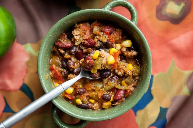 We LOVE this Crockpot Mexican Pumpkin Chili recipe. This slow cooker dinner is filled with vegetables and Mexican spices such as green chiles, salsa verde and cumin! You can freeze leftovers!