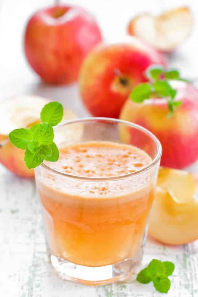 How to Make Apple Juice with a Juicer!  Easy step by step instructions on how to make fresh, healthy apple juice.   Save this recipe for when you go apple picking!  Also includes how to freeze juice!