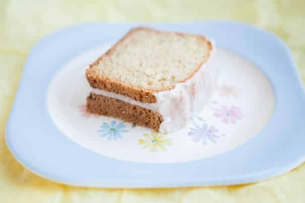 RECIPE for the BEST fluffy and moist Lemon Glazed Zucchini Bread!   There's 2 cups of grated fresh zucchini baked into this easy to make beautiful bread. On top there's a lemon powdered sugar glaze frosting!