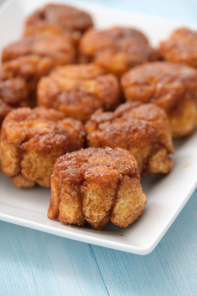 monkey bread muffins on white plate on blue table