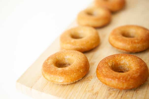 Baked Cinnamon Sugar Pumpkin Cake Donuts! This easy homemade recipe makes soft, delicious Pumpkin Donuts that are ready in under 30 minutes! Recipe makes 1 dozen donuts. One of the BEST Fall Pumpkin dessert recipes!