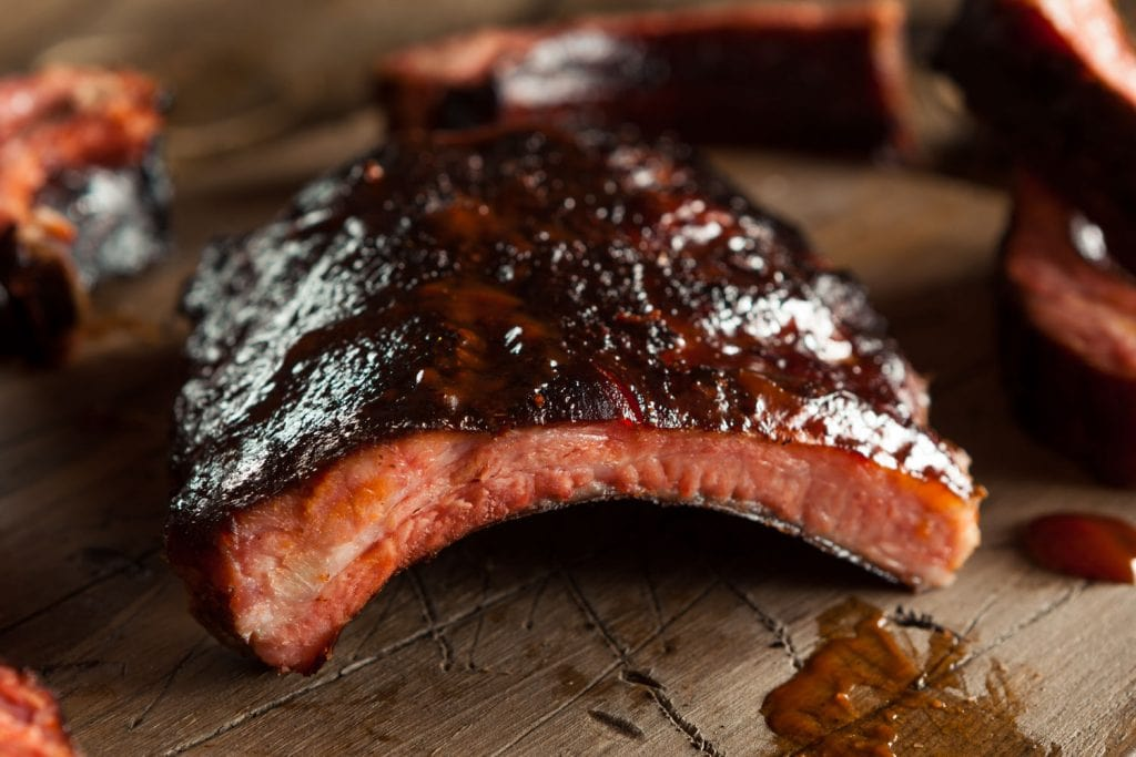 bbq spare ribs covered in barbecue sauce