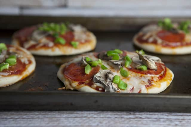Mini Pizza Biscuits recipe makes individual mini pizzas using Pillsbury biscuits in 15 minutes.