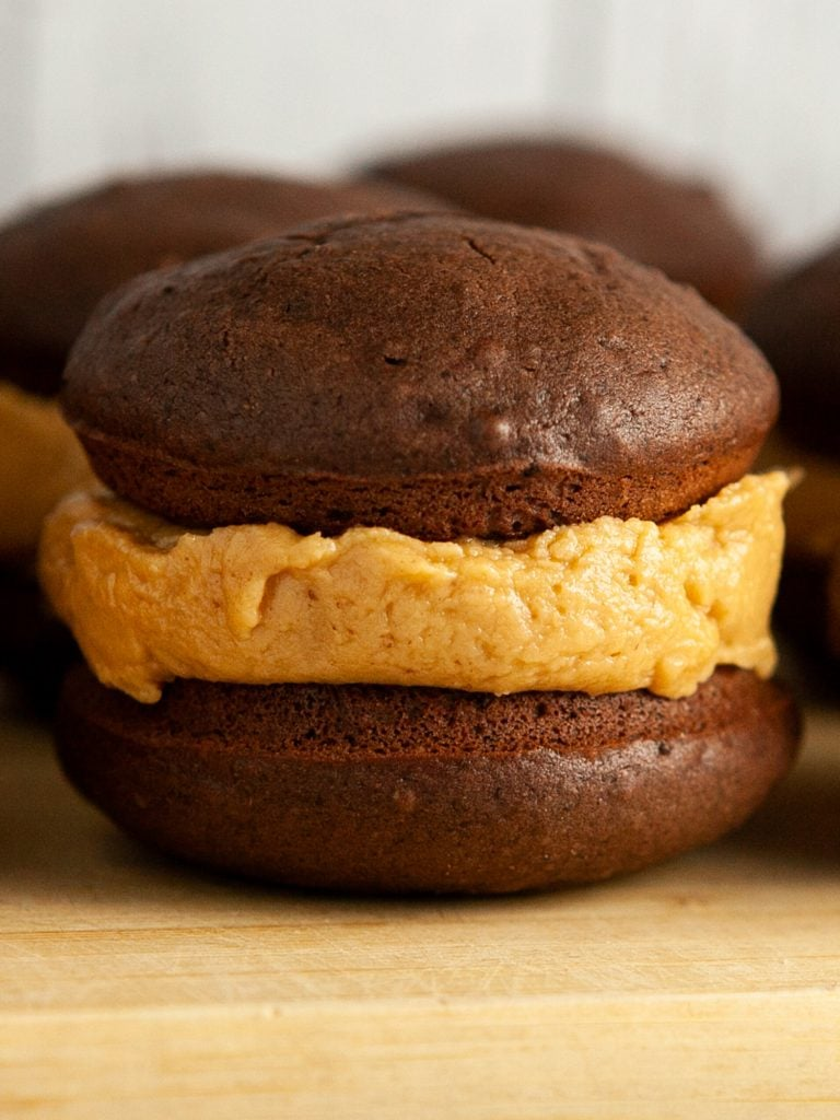 closeup of chocolate whoopie pie with peanut butter frosting in it.