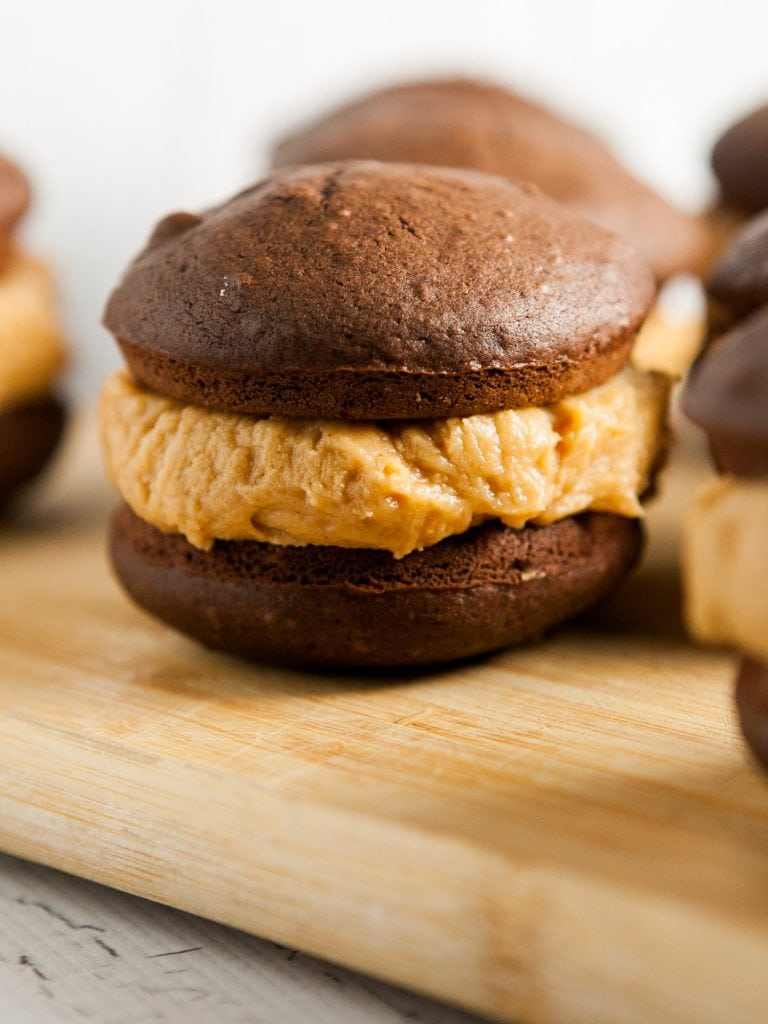 chocolate whoopie pies on table.