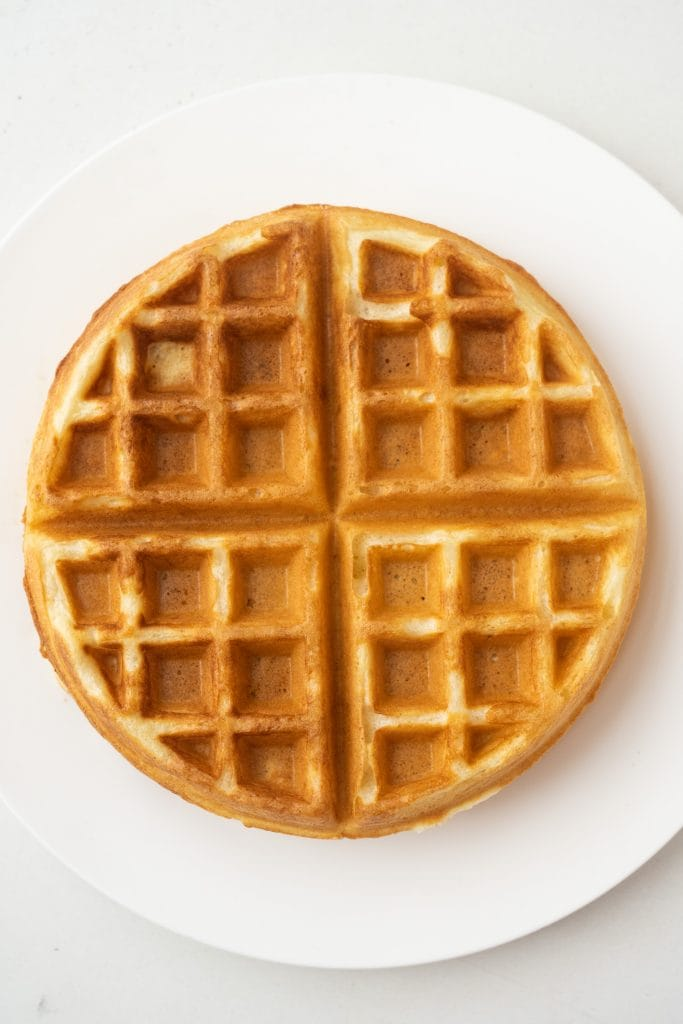 buttermilk waffle on plate on table.