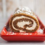 HOW TO make the BEST Pumpkin Roll With Cream Cheese Filling- don't worry it's easy!  This delicious homemade Pumpkin Roll recipe is easy to make and walks you through the steps on how to make it.  The roll is so moist and delicious!  My family considers this the best pumpkin recipe and it's always requested for Thanksgiving!