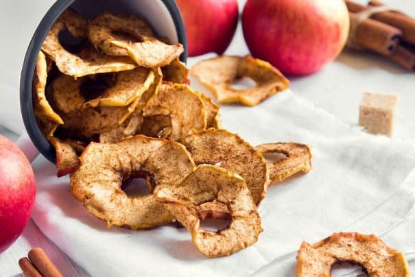 A crispy Apple Chips recipe with sea salt that is healthy and easy to make! We worry about gaining weight with all those chips we consume while sitting in front of the TV! These homemade baked apple chips are healthy snacks to replace your favorite bag of potato chips!