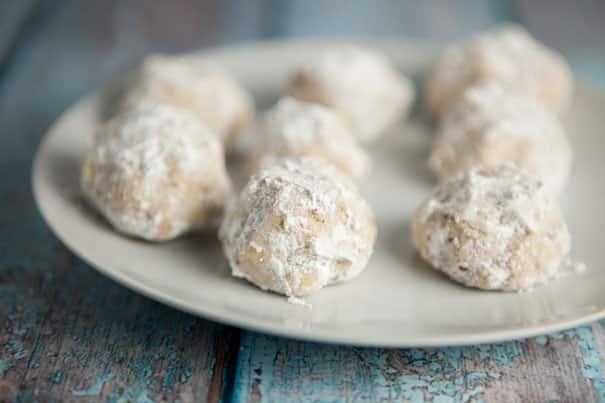 These Russian Tea Cakes are so easy to make and they are my absolute favorite Christmas cookie recipe! They're made with pecans and then rolled in powdered sugar after baking for a light, tender cookie you're sure to love. I always make a few batches to hand out for gifts around the holidays and everyone always loves them.