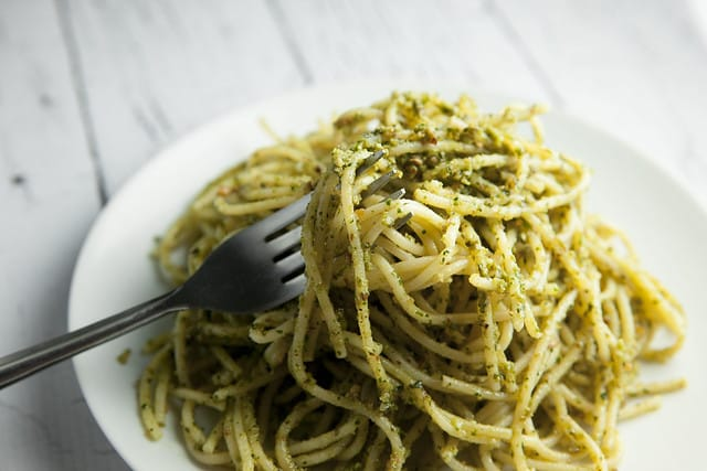 BUDGET FRIENDLY Basil Pesto Pasta recipe made with fresh basil and almonds! This easy, healthy homemade recipe makes delicious basil pesto that can be served over pasta, as appetizers or on a sandwich! Pine nuts are expensive so this is a much more budget friendly pesto.