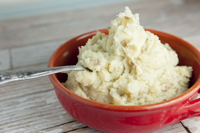 These CREAMY Garlic DAIRY FREE Mashed Potatoes are the best! Enjoy this easy to make mashed potatoes recipe that uses broth and olive oil instead of dairy products! Perfect for everyday dinner or Thanksgiving - you won't believe how good these are!