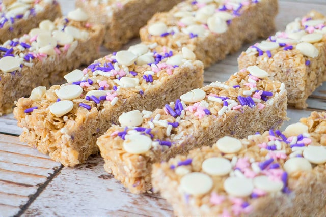 Birthday Cake Batter Granola Bars that taste just like cake and are topped with chocolate chips and sprinkles!