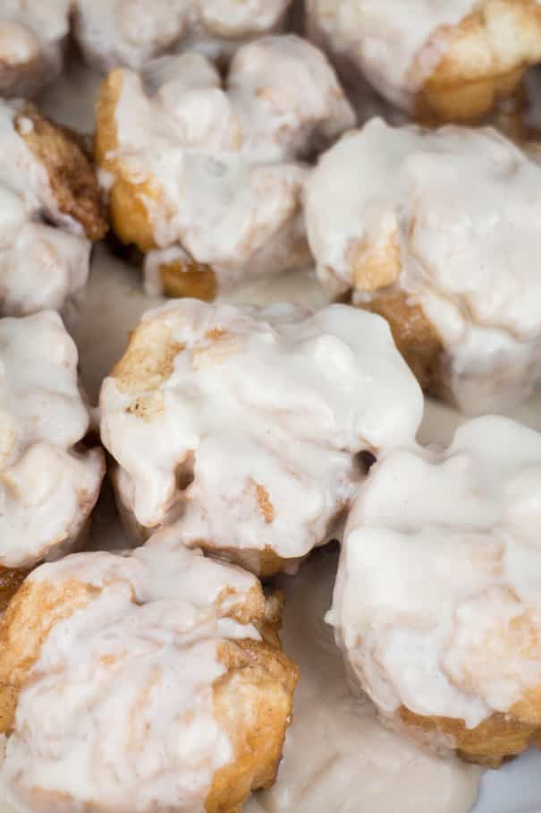 Easy Cinnamon Rolls recipe ready in 12 minutes! Use refrigerated biscuits to make homemade Cinnamon Rolls with a powdered sugar icing that your kids will fall in love with! These Cinnamon Rolls are quick and delicious - perfect for Saturday morning breakfast.