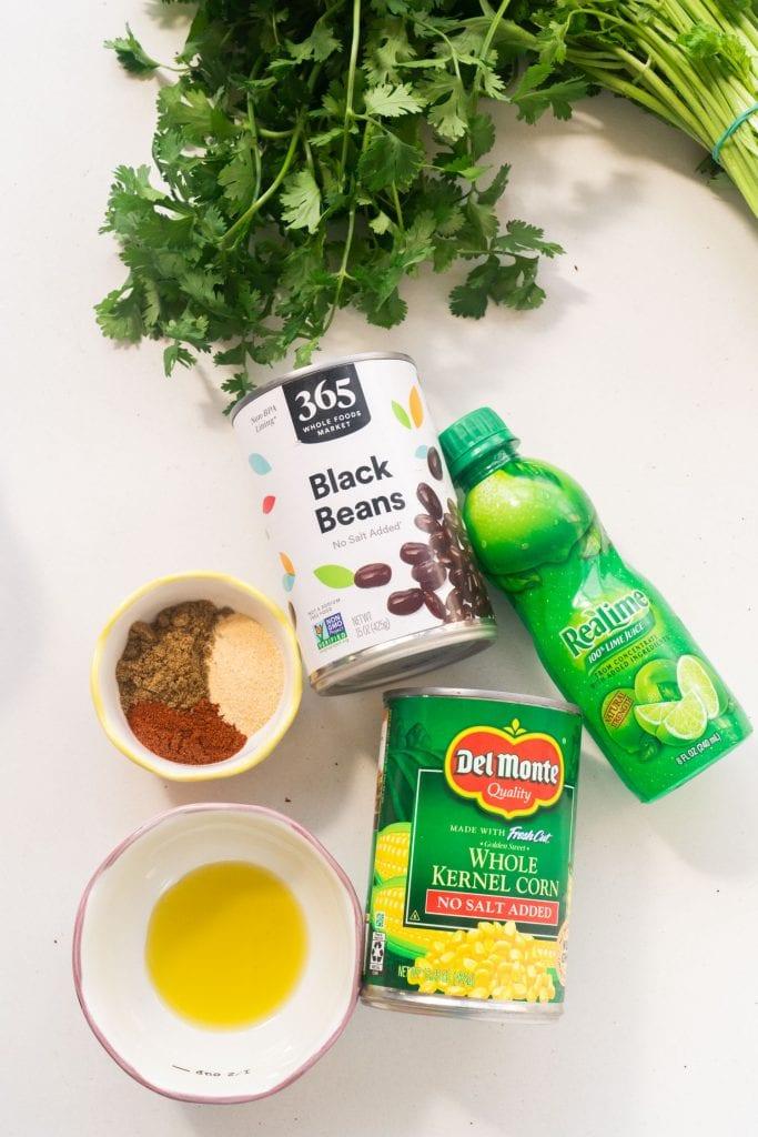 supplies on white table to make black bean corn salsa.