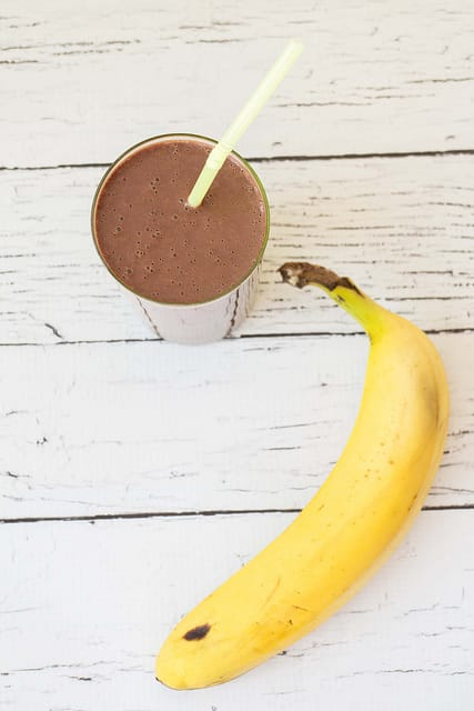 This Double Chocolate Banana Smoothie is a healthy breakfast smoothie recipe!   It uses frozen bananas which you can store in the freezer for whenever you want a smoothie!
