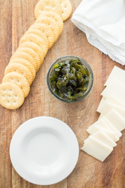 3 INGREDIENT Candied Jalapenos recipe! You only need jalapenos, sugar and water to make this delicious SWEET and SPICY recipe! Everyone goes CRAZY when I make these with our garden peppers! Use this as a appetizer dip, on top of crackers or in dinner dishes! Store in refrigerator or use for canning!