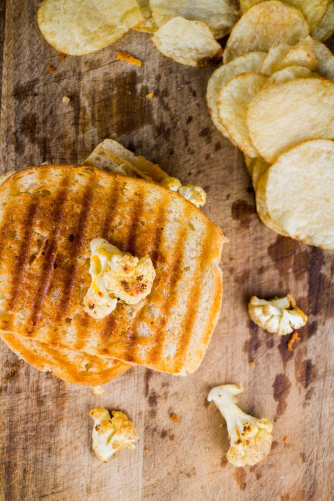Easy, delicious Cauliflower Grilled Cheese Sandwich ready in 15 minutes.  It's a classic sandwich but looks fancy with roasted cauliflower and jalapeno peppers.