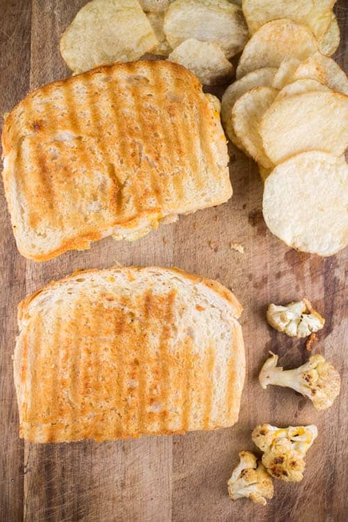 This is a ooey gooey delicious grilled cheese sandwich with cauliflower and jalapeno peppers!