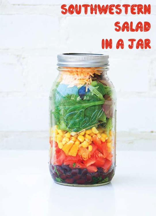 Easy to make Mason Jar Southwestern Salad. This healthy salad includes lime, black beans, tomatoes, peppers, avocado, corn, salad green and cheddar cheese.