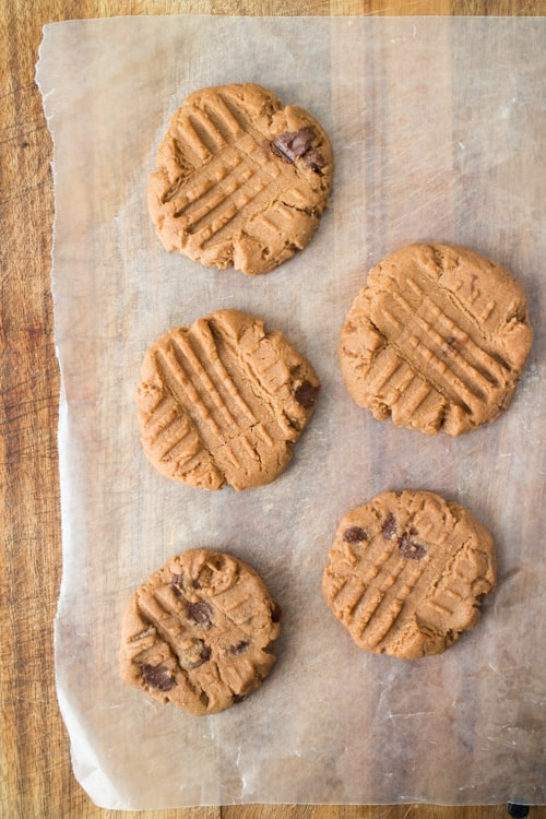 CHUNKY Chocolate Chip Peanut Butter Cookies is an easy homemade from scratch recipe.  These are one of my most requested cookies to bake from my family and is always sold out at bake sales!