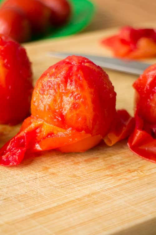 Easy step by step instructions with pictures on how to make diced tomatoes from fresh tomatoes. Steps walk you through the beginning all the way up to freezing them. This is a great way to preserve garden tomatoes if you're picking a lot of them!