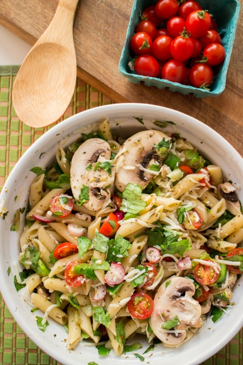 Fresh Pasta Salad recipe that tastes just like Summer! Recipe ingredients include cherry tomatoes, radishes, green pepper, lettuce and mushrooms! This is perfect for a healthy dinner or picnic lunch.