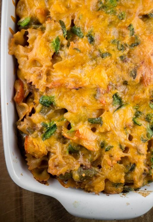 Cheesy Taco Casserole is a easy to make, comfort food recipe. Perfect for Taco Tuesday recipes! It has plenty of fresh vegetables (green pepper, tomatoes, jalapeno peppers), along with tomato soup that is going to hold those noodles together and soak up the good stuff.