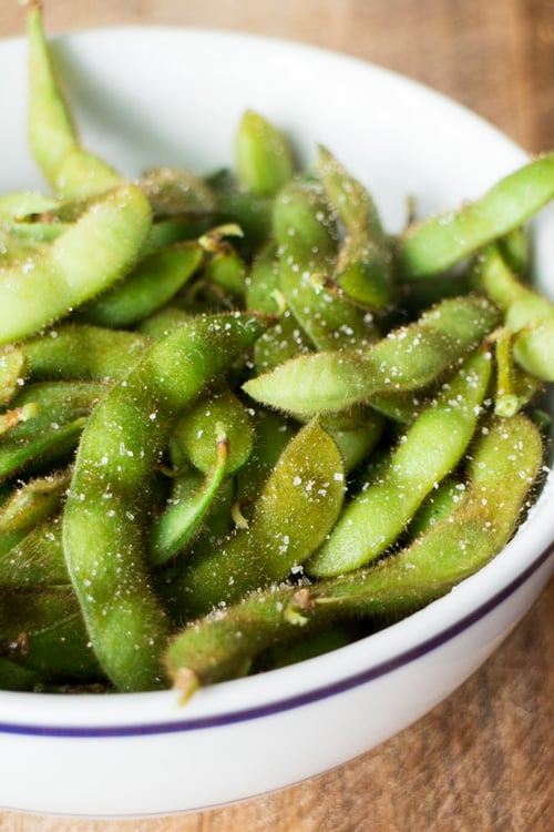 Edamame is easy to make at home and tastes just like the Japanese restaurant! All you need is soybeans and salt!