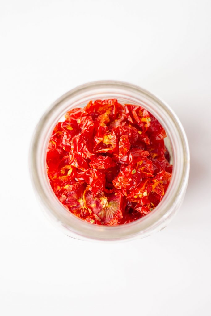 dried tomatoes in glass jar.