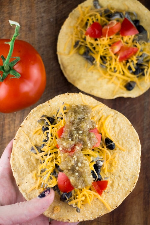 Slow Cooked Tomatillo Salsa Roja Chicken Tacos is a delicious authentic Mexican recipe made in your slow cooker. These are so easy to make and perfect for feeding a crowd!