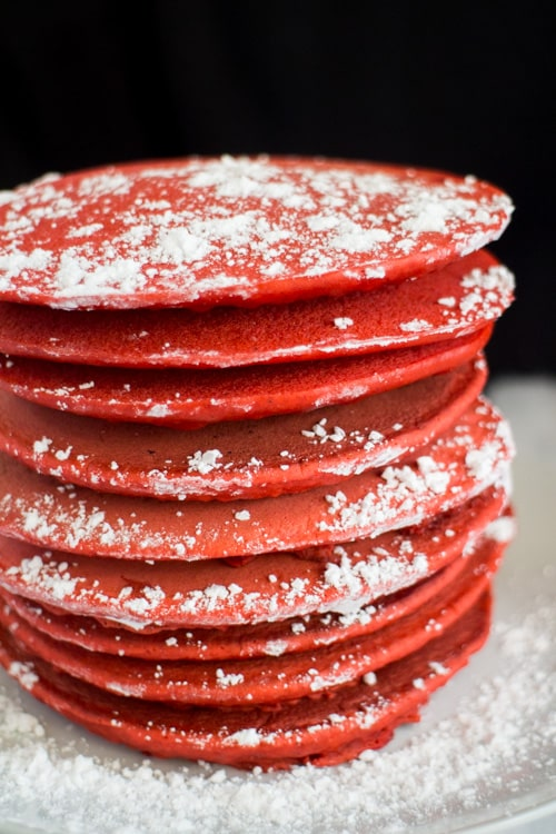 These CHRISTMAS Gingerbread Pancakes are the perfect breakfast option around the holiday season! Full of gingerbread flavor, these red pancakes are fluffy and fun for the holidays! These pancakes are easy to make and the recipe comes together in no time. Serve them with powdered sugar and a frosting tree on top! Perfect for Christmas morning breakfast!