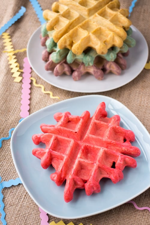Big FLUFFY Belgian Rainbow Waffles are easy to make, taste delicious and will make any celebration even more special! This rainbow waffle recipe is the perfect birthday breakfast in bed and a good one to serve up on St. Patrick's Day (or any day)!