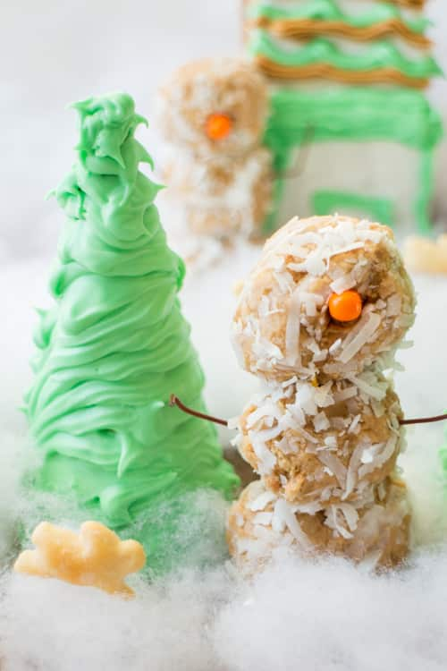 Snowman Peanut Butter Balls is a fun and delicious recipe for the entire family to make together! They're so cute everyone will love them!