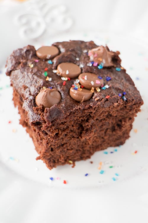 HEALTHY TRIPLE Chocolate Brownies that are low calorie because they're made with applesauce and egg whites!  This easy recipe makes super moist chocolate brownies, perfect for chocolate cake lovers!   Make sure to add rainbow sprinkles on top!