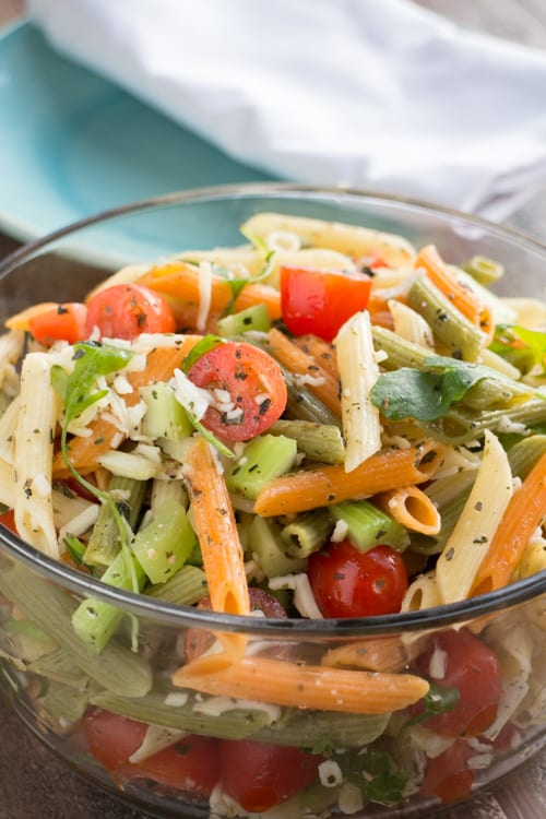 EASY Italian Pasta Salad recipe!  This vegetarian recipe uses Italian dressing, tri color pasta, fresh cherry tomatoes, celery and arugula! It's the perfect garden Summer salad!