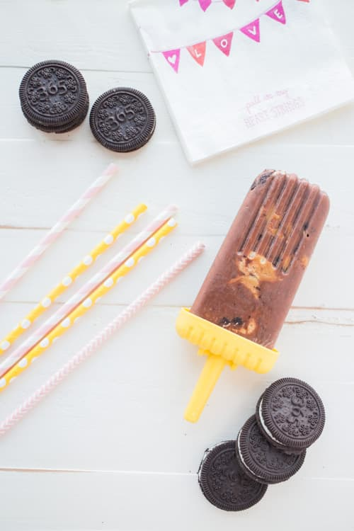 Easy to make Chocolate Oreo Peanut Butter Popsicles recipe! Your entire family will love these Summer ice cream treats!