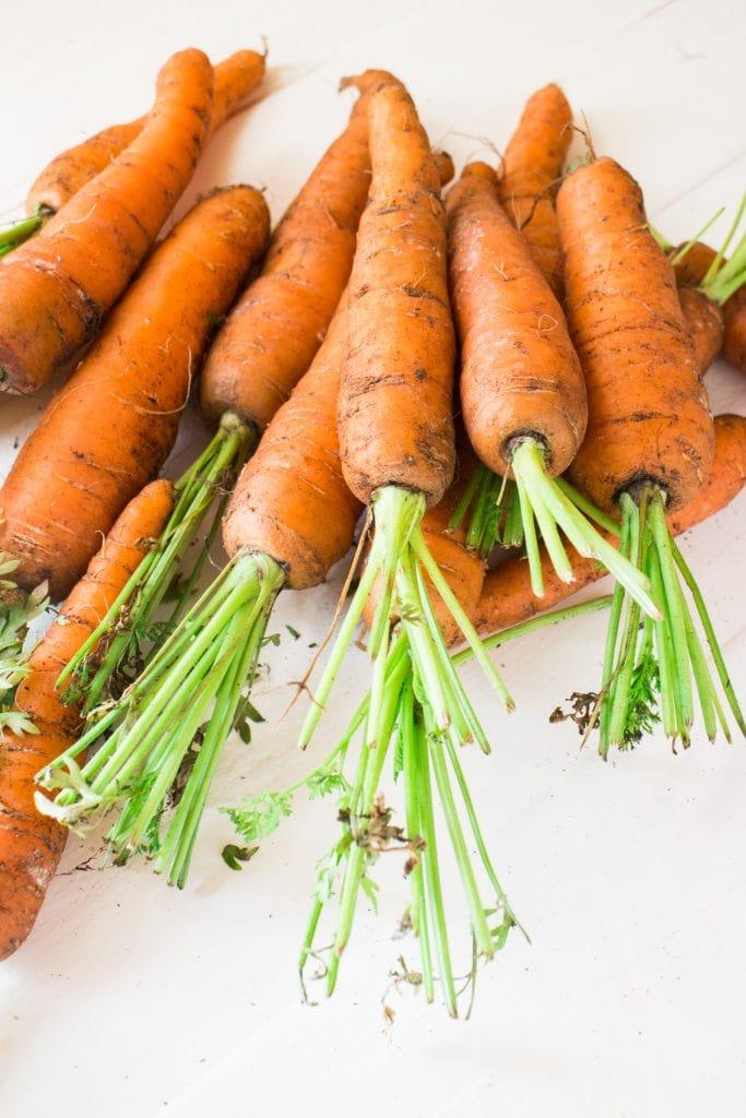 fresh carrots on table.